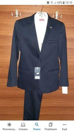 Продам два б/у школьных кастюма пр-ва Турция фирмы Армани. Возраст 13