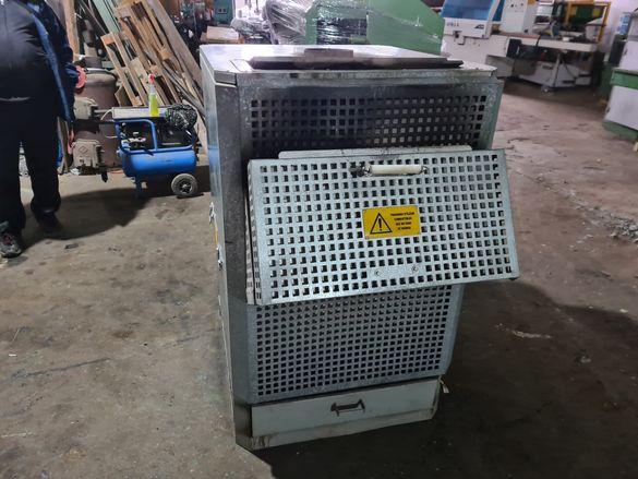 Генератор за горещ въздух на твърдо гориво.