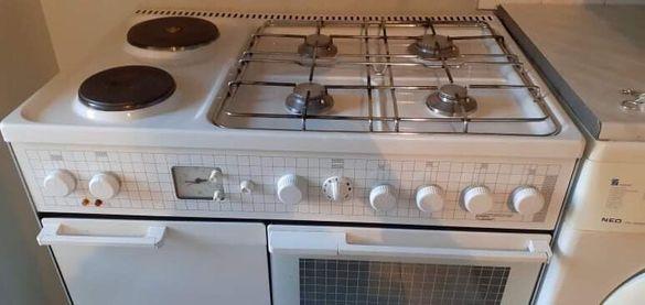Готварска печка 4газ ,2ел.фурна с грил и място за бутилка .