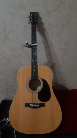 сатылады гитара..