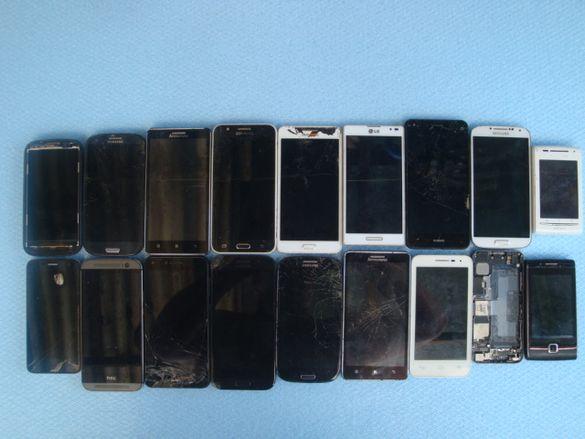 Лот от 18 счупени смартфони за части