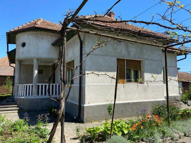 Casa 5 camere + teren 1.074mp + axene + garaj + gradina