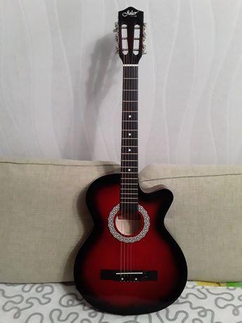 Продам гитару  qoker