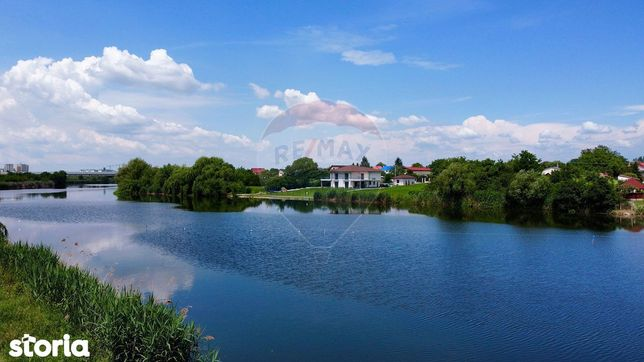 Repozitionare pret teren spectaculos la lac si acces rapid in oras