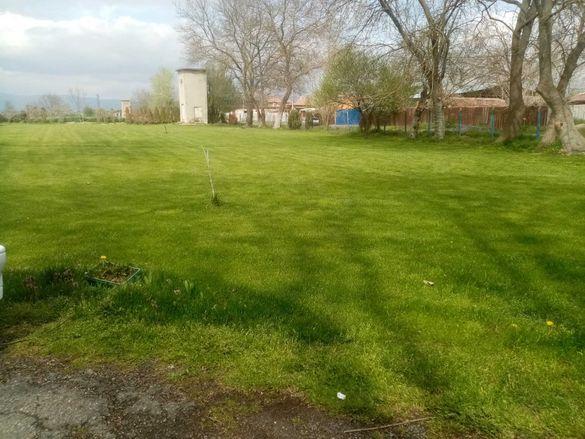 Косене на тревни площи .