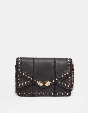 Нови дамски кожени чанти във черен цвят на Stradivarius и Mango