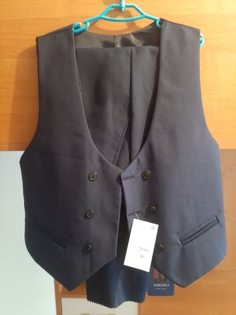 Продам жилетку и брюки для мальчика