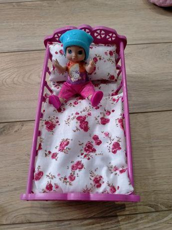Продам маленькую куколку с кроваткой.