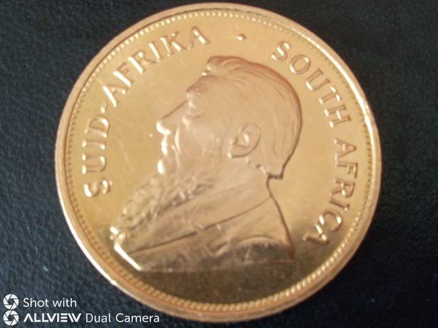 monedă aur 22 K , Krugerrand (1 uncie aur 24 K)