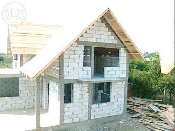 Constructii case la rosu.amenajarii interioare si exterioare