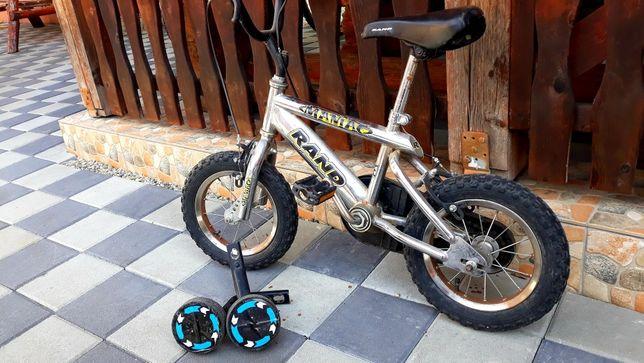 Bicicleta cu roți ajutătoare pentru copii
