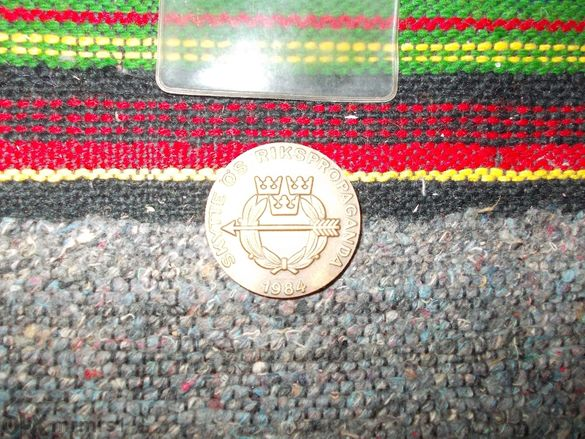 Шведски медал в опаковка