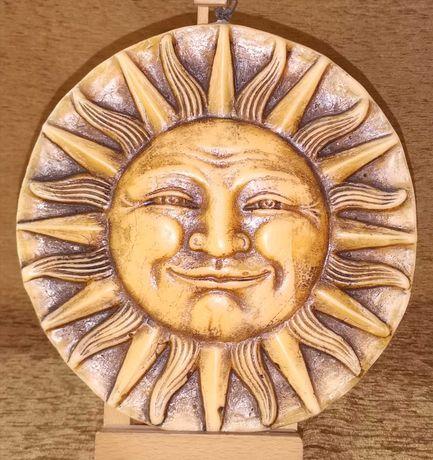 Decoratiune din ceara model soare.