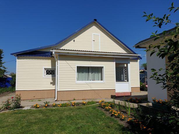 Продам дом ,центральное отопление,80кв.м