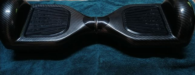 Vând sau schimb hoverboard stare excelentă