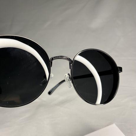 Солнецезащитные очки