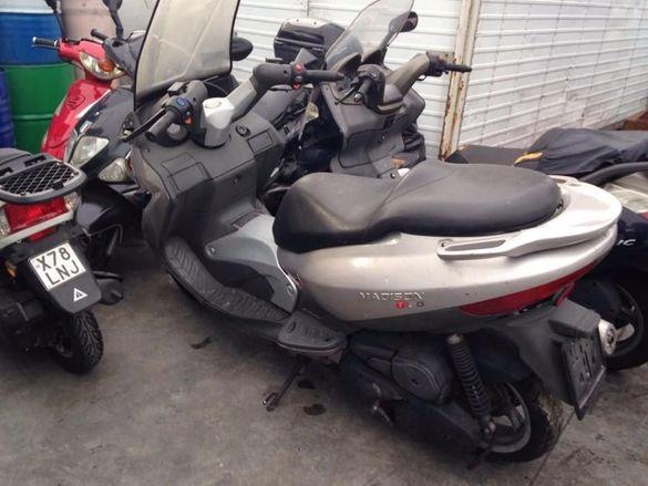 Мотоцикет,скутер Сим Джоймакс ( sум Joymax ) 300i evo-на части