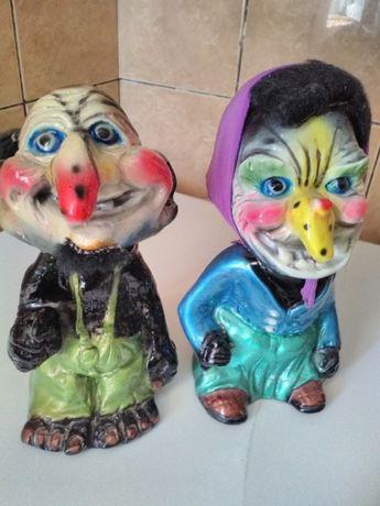 Cuplu statuete batrani ,cu arc intre cap si corp, ptr cmera copilului