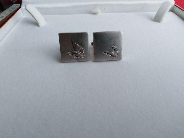 Butoni vechi de argint