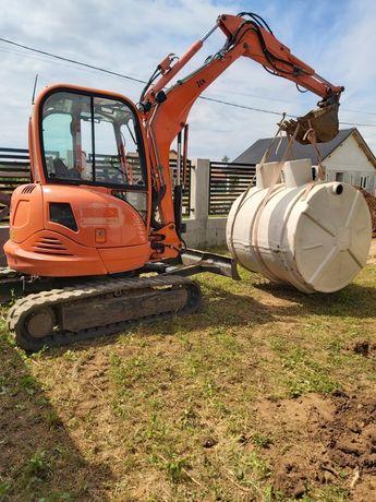 Miniexcavator închiriat bobcat sapat canalizare fose septice transport