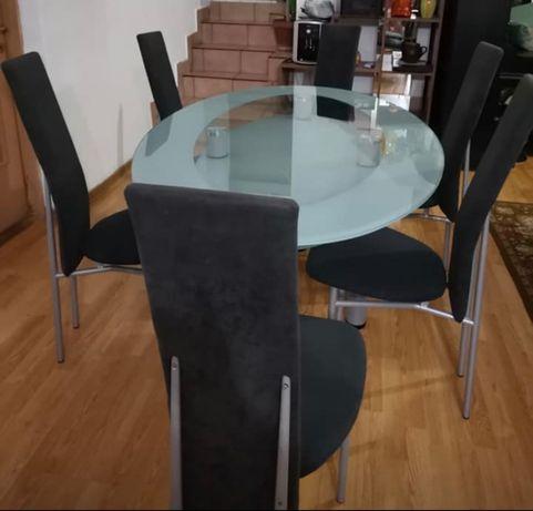 Masa din sticla cu picioare de inox + 6 scaune