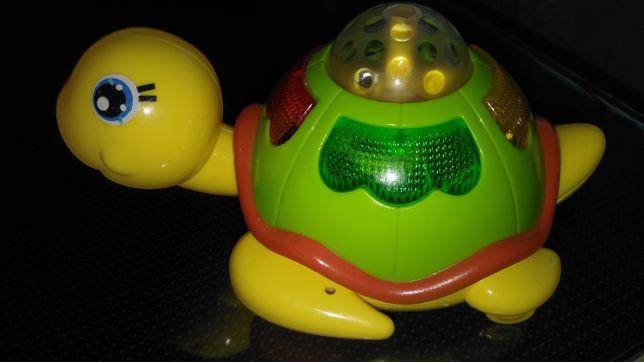 Детская игрушка черепаха.