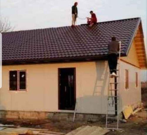 Case pe piloni sau fundație din structura metalica și panou sandwich