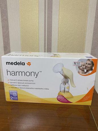 Молокоотсос Medela новый