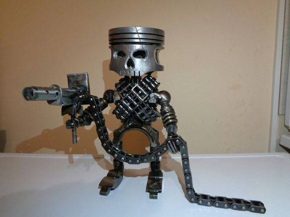 Робот от метал авточасти бутоло арт скулптура