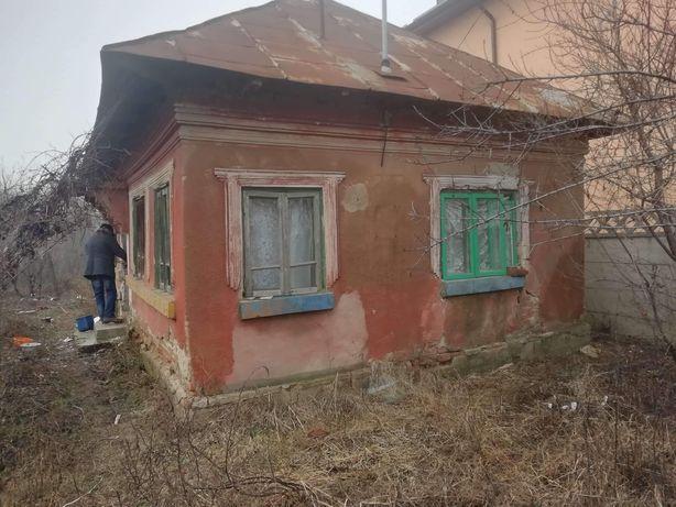 Vând teren + casa