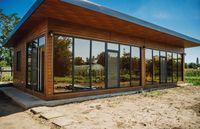 Cofectionam case pe structura metalica învelită cu panouri sendwis