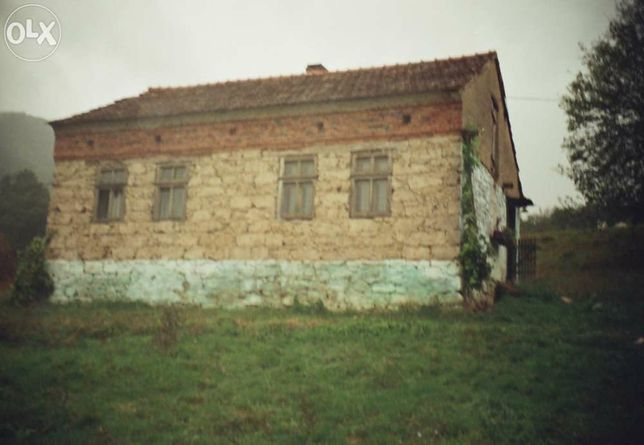 Casa cu teren 1,7+1,6 Ha, 2 cam, izvor ,curent ,acte la zii