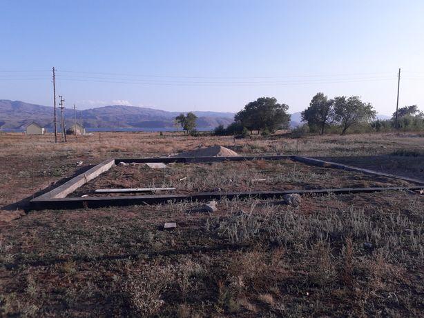 Продам участок 0,15 Га в селе Сарыбел+фундамент+вагончик 2-хкомнатный
