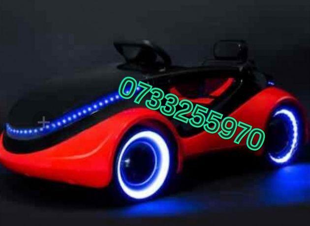 Mașina electrica cu led pe roți, telecomand mp3 stick lumina micro sd