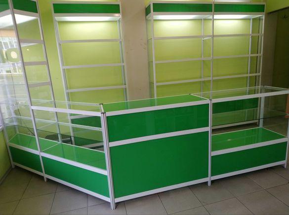 Търговско оборудване за магазин ( 8 стелажа,2 щанда ,касов модул )