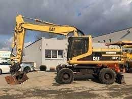 Dezmembrez excavator pe roti Caterpillar M318