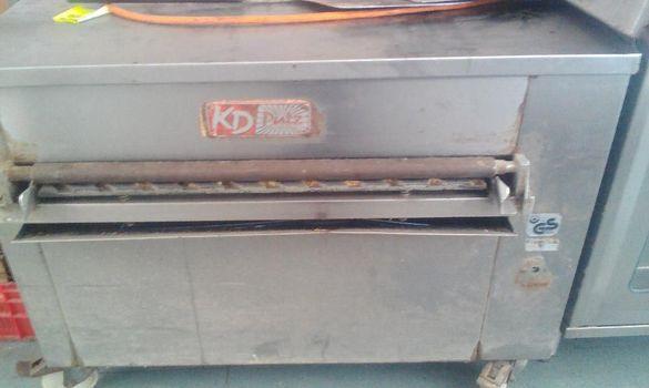 Професионална машина за почистване на пекарски тави