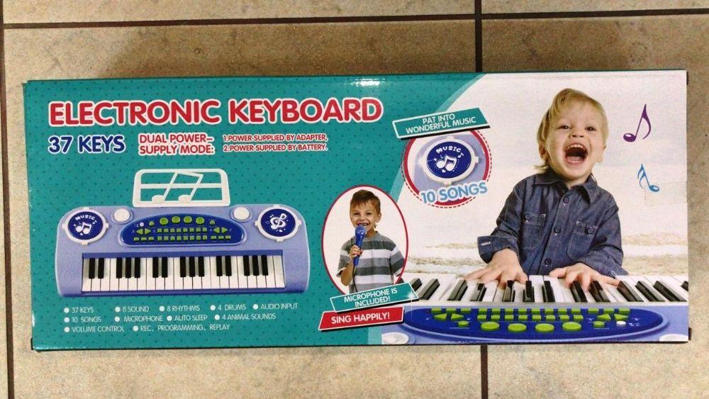 Клавишный синтезатор 37 клавиш голубой с микрофоном