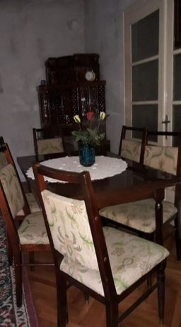 masa de 12 persoane in buna stare,cu 6 scaune