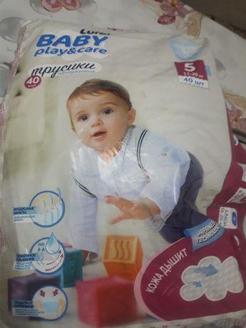 Продам памперсы подгузники