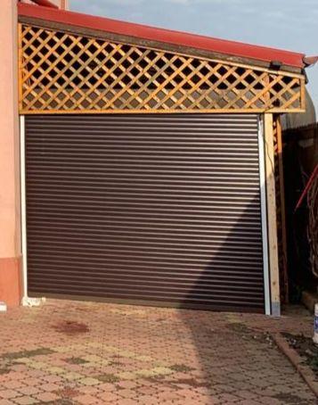 Usa de garaj electrica cu tel. si manivela de serv, lamela de 55 si 77
