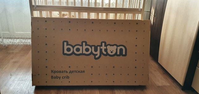 Детская кроватка фирмы Babyton с матрасом