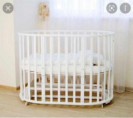 Продам круглую кроватку с 2 мя матрасами