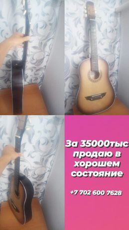 Продам гитару в хорошем состоянии струны родные