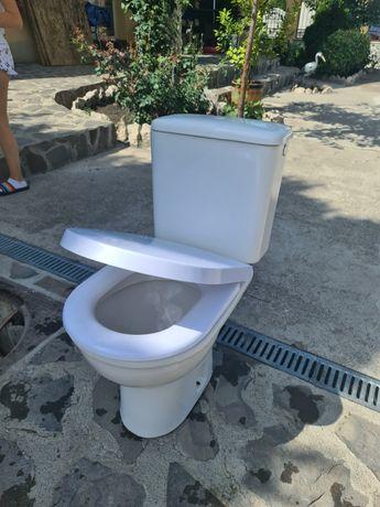 Vând toaleta  capac amortizor