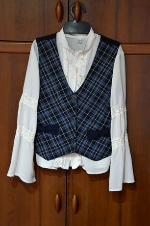 Школьная форма на рост 140 (жилет, юбки, блузки)