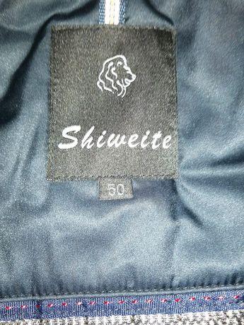 Продам зимнюю куртку (верблюжий пух). Цена 55000