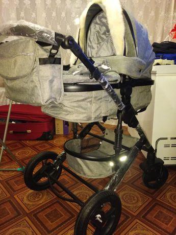 Продам коляску зима лето новый в салофане не пользовались