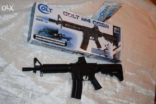 Pusca cu aer comprimat / Mitraliera Airsoft + Bonus Bile 6mm NOUA Colt