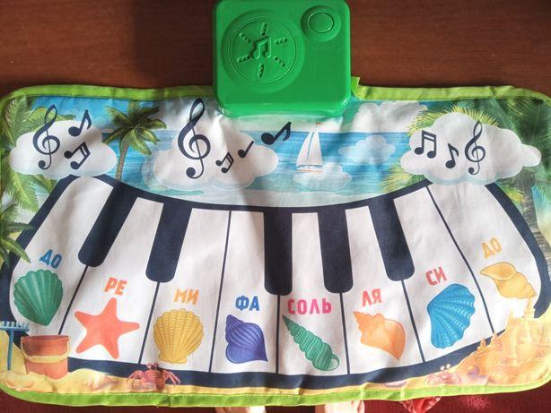 Музыкальный коврик-пианино.
